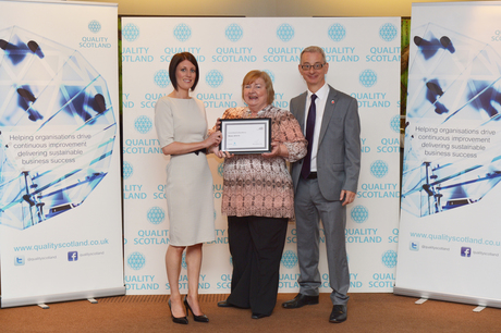 Anne McGuigan & Vincent Iles receiving a Committed to Excellence award on behalf of The Richmond Fellowship Scotland from Quality Scotland CEO Claire Ford